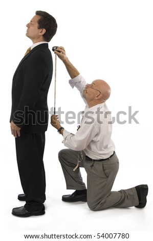Man getting measured by a tailor on a white background. - stock photo