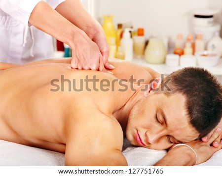 Man getting relaxing massage in spa. - stock photo