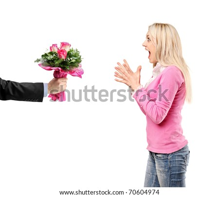 Man giving a bunch of flowers and surprised woman isolated on white background - stock photo