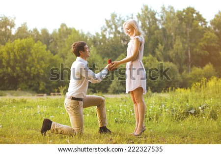 Man giving a ring woman, love, couple, date, wedding - concept - stock photo