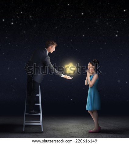 Man giving a star from the sky to a woman  - stock photo