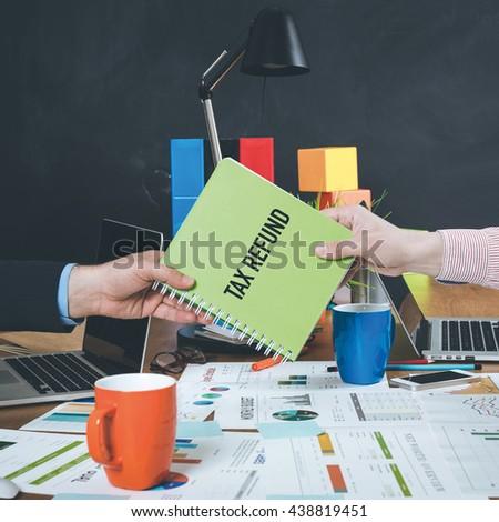 Man giving book which written Tax Refund - stock photo
