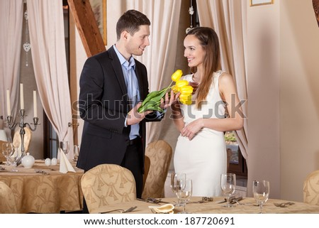 Man giving bouquet of tulips his girfriend - stock photo