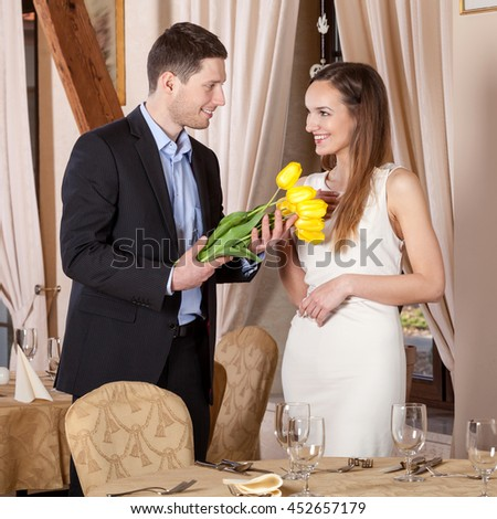 Man giving bouquet of tulips his girfriend