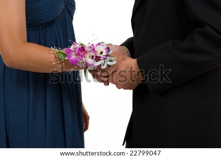 Man giving corsage to woman ( prom or wedding) - stock photo