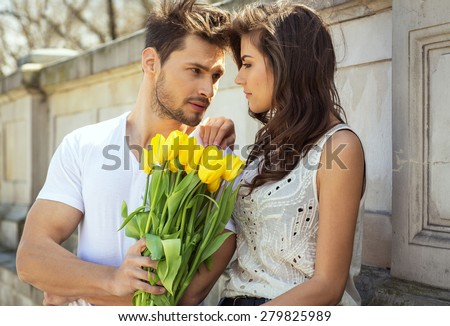 https://thumb7.shutterstock.com/display_pic_with_logo/999518/279825989/stock-photo-man-giving-flowers-woman-279825989.jpg