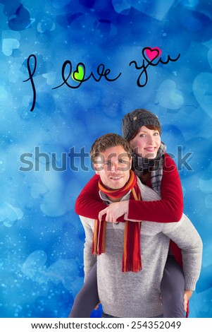 Man giving girlfriend piggy back against valentines heart design - stock photo