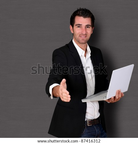 Man giving hand for handshake - stock photo