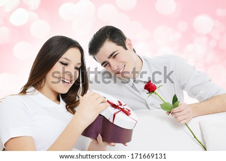 Man giving heart shape gift box to a woman!Valentine's day!