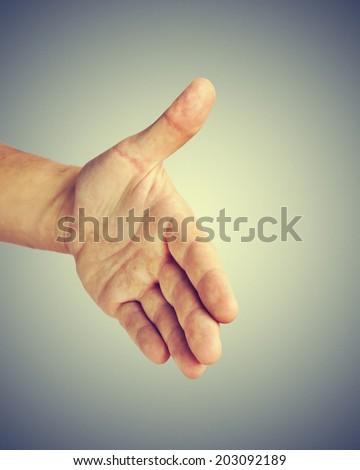 Man giving his hand for handshake - stock photo