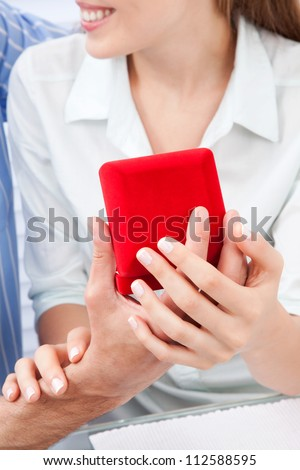 Man giving jewelry present to woman - stock photo