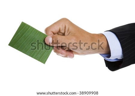 Man giving out a green business card or paying using an ecofriendly credit card