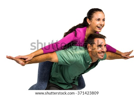 Man giving piggy back to his girlfriend on white screen - stock photo
