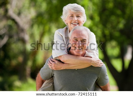Man giving wife a piggyback - stock photo