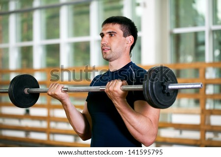 man goes in for sports in sport hall - stock photo