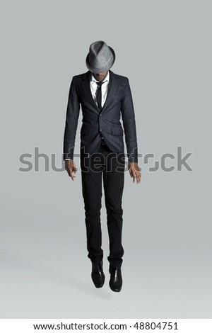 Man goes straight up in his business suit - stock photo