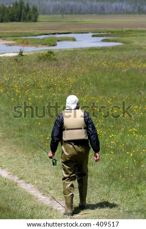 man going fly fishing - stock photo