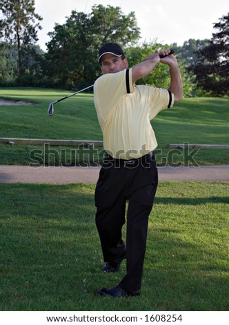 Man golfing. - stock photo