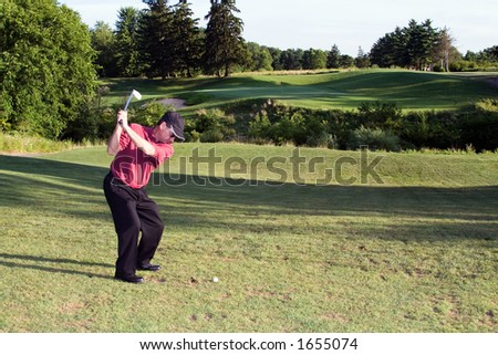 Man golfing - beautiful golf course landscape and green in the distance. - stock photo