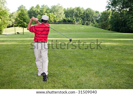 Man golfing on a summer day.