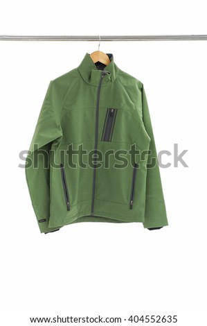Man green clothes on hanger. - stock photo