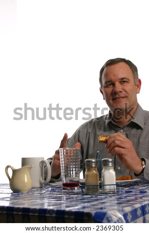 Man greeting friend with smile at lunch - stock photo