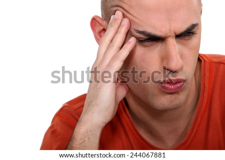 Man grimacing, white background - stock photo