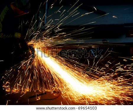 Man Grinding in a workshop - stock photo