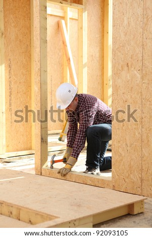 Man hammering nail - stock photo