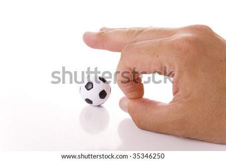 Man hand and soccer ball isolated on white background - stock photo