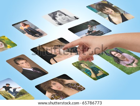 Man hand choosing portraits from my gallery - stock photo