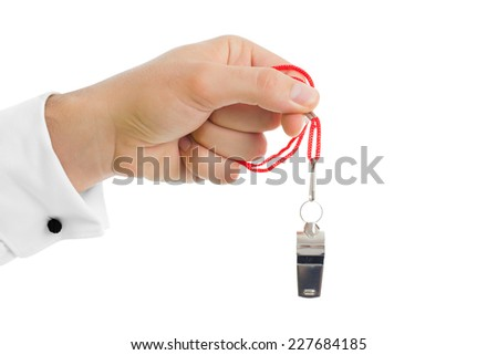 Man hand close up over white background. Using a whistle - stock photo