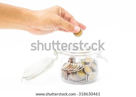 Man hand fill coin into piggy bank saving, The concept of financial assets. - stock photo