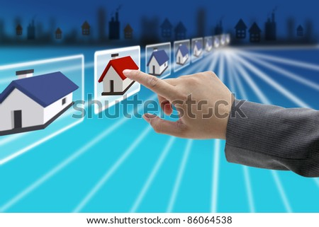 man hand Finding new property in real estate market with electronic commerce concept - stock photo