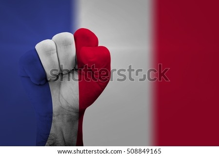 Man hand fist of FRANCE flag painted
