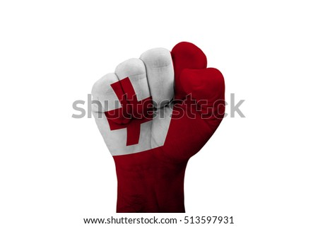 Man hand fist of TONGA flag painted