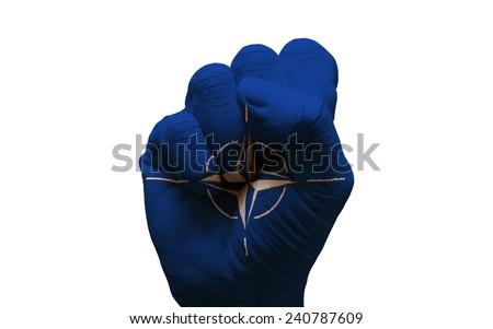 man hand fist painted alliance flag of nato - stock photo
