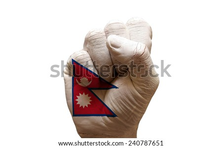 man hand fist painted country flag of nepal - stock photo