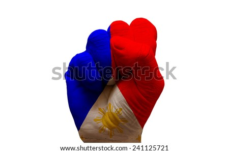 man hand fist painted country flag of philippines - stock photo