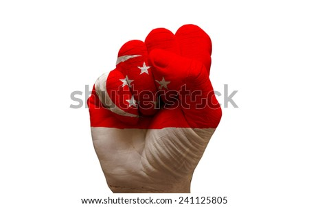 man hand fist painted country flag of singapore