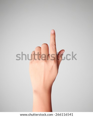 Man hand forefinger indicating of the direction - stock photo