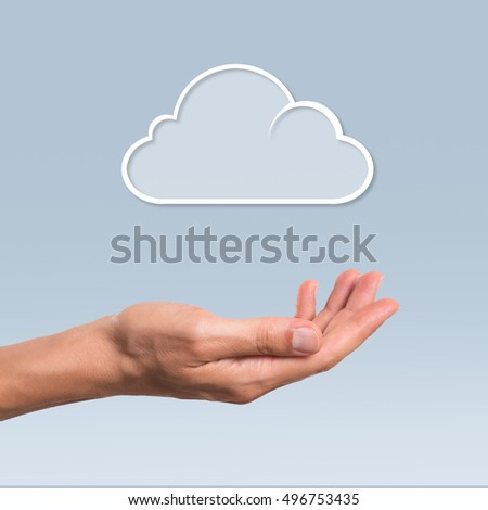 Man hand hold a cloud symbolyzing the cloud computing. Internet and cloud computing technology.