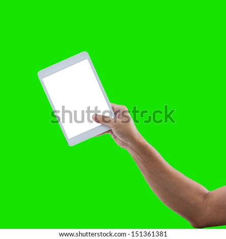 Man hand hold digital tablet isolated on green background with clipping path - stock photo