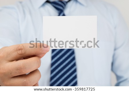 Man hand holding a business card