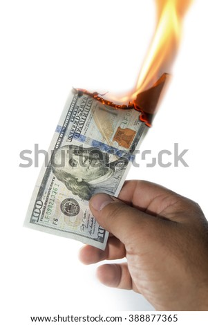 man hand holding a 100 dollars note burning on white background