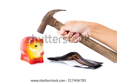 Man hand holding a hammer will knock into Pig piggy bank saving. The concept of financial assets, reliability deposits, insurance savings. - stock photo
