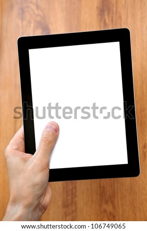 man hand holding a tablet touch computer gadget with a isolated screen with the background of the tree