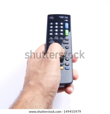 man hand holding a tv remote - stock photo