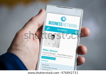 man hand holding business network web smartphone. All screen graphics are made up.