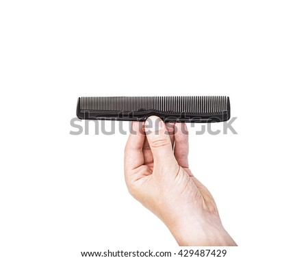 man hand holding comb isolated on the white background closeup. Hairdresser salon, barber shop, perfect look, modern technique, new hairdo concept - stock photo